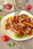 Chicken salad with dried tomatoes and sweet peppers Stock Photography