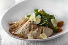 Chicken salad with eggs, lettuce and tomatoes stock images