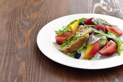Chicken salad with fresh berries and arugula Royalty Free Stock Photography