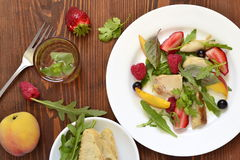 Chicken salad with fresh berries and arugula Royalty Free Stock Photo