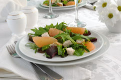 Chicken salad with grapefruit and a  fresh salads Stock Image