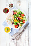 Chicken salad. Grilled chicken fillet with fresh vegetable salad on white wooden background, top view stock image