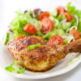 Chicken with salad and herbs Royalty Free Stock Photo