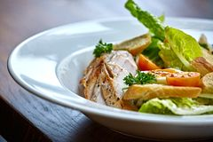 Chicken salad with leaf vegetables, chard, eggs, bulgur and cherry tomatoes. Stock Photos
