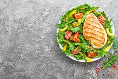 Chicken salad. Meat salad with fresh tomato, sweet pepper, arugula and grilled chicken breast. Chicken fillet with fresh vegetable Stock Photography