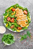 Chicken salad. Meat salad with fresh tomato, sweet pepper, arugula and grilled chicken breast. Chicken fillet with fresh vegetable Stock Photos