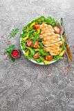 Chicken salad. Meat salad with fresh tomato, sweet pepper, arugula and grilled chicken breast. Chicken fillet with fresh vegetable stock images