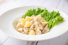 Chicken salad with pineapple. And mushrooms on wooden boards Stock Photo