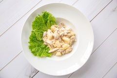 Chicken salad with pineapple. And mushrooms on wooden boards Stock Photos