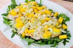 Chicken salad with ruccola and mango Royalty Free Stock Photos
