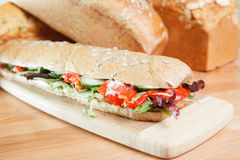 Chicken salad sandwich and loaves of bread Stock Photo