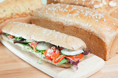 Chicken salad sandwich and loaves of bread Stock Images