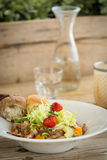 Chicken salad served with two bread rolls Stock Photos