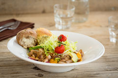 Chicken salad served with two bread rolls Stock Photo