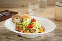 Chicken salad served with two bread rolls Royalty Free Stock Image