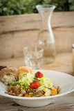 Chicken salad served with two bread rolls Stock Image