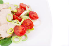 Chicken salad with tomatoes and leek. Royalty Free Stock Image