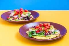 Chicken and Salad Tortilla with Avocado on Orange and Blue Background Stock Photos