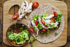 Chicken and salad tortilla. Open tortilla with chicken, avocado and tomatoes Stock Images