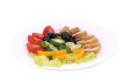 Chicken salad and vegetables. Royalty Free Stock Photography