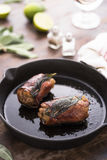 Chicken saltimbocca in a skillet Stock Photo