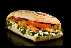 Chicken sandwich. Grilled chicken sandwich on a black background royalty free stock photo