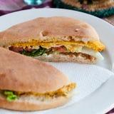 Chicken sandwich. Closeup of chicken sandwich with mustard served on a white plate Stock Photos