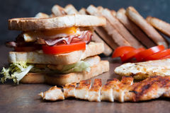 Chicken Sandwich. Closeup, wooden background Royalty Free Stock Photo