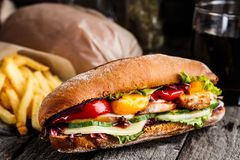 Chicken sandwich, fries and glass of soda Royalty Free Stock Image