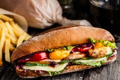 Chicken sandwich, fries and glass of soda Royalty Free Stock Photo