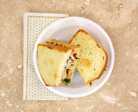 Chicken sandwich on plate with napkin Stock Photos