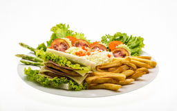 Chicken sandwich on a white plate with french fries Stock Image