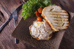 Chicken sandwich. On wooden table background Stock Photos