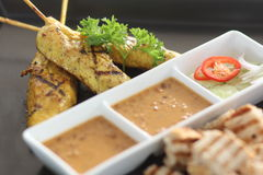 "Chicken Satay. Chicken ""Satay"" grilled with peanut sauce  and pickled cucumber Stock Image"
