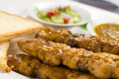 Chicken satay with bread Royalty Free Stock Image