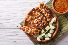 Chicken satay with a delicious peanut sauce. horizontal top view Royalty Free Stock Images