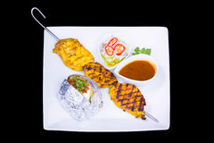Chicken satay with delicious peanut sauce Stock Photography
