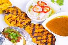 Chicken satay with delicious peanut sauce Royalty Free Stock Photography