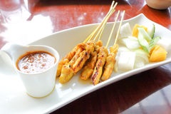 Chicken satay grill. With sweet peanut sauce rice and salad Royalty Free Stock Image