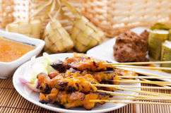 Chicken satay and ketupat Stock Photos
