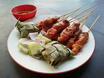 Chicken satay. With ketupat served on plate stock image