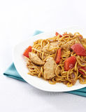 Chicken Satay noodles. Plate of chicken satay noodles with red peppers and onions Stock Photography