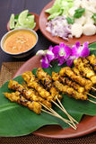 Chicken satay with peanut sauce, indonesian skewer cuisine Royalty Free Stock Image