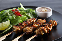 Chicken satay popular asian dish Royalty Free Stock Image