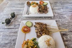 Chicken Satay or Sate Ayam. Malaysian famous food. Is a dish of seasoned, skewered and grilled meat, served with a peanut sauce royalty free stock photography