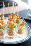 Chicken satay skewers served in a glass Royalty Free Stock Photo