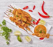 Chicken satay on skewers with sauce stock photography