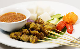 Chicken Satay on white plate Royalty Free Stock Image