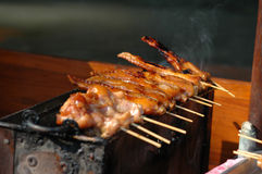 Chicken Sate. Skewers on an outdoor grill at food stalls in Bangkok, Thailand Stock Photos