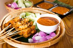 Chicken sate with delicious peanut sauce, ketupat, onion and cuc Royalty Free Stock Image